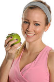 Young Woman holding a green apple — Stock Photo