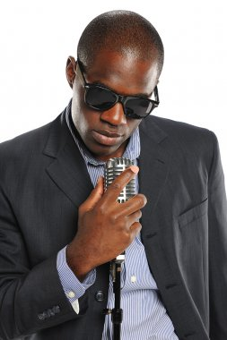 African American Singer holding a vintage microphone