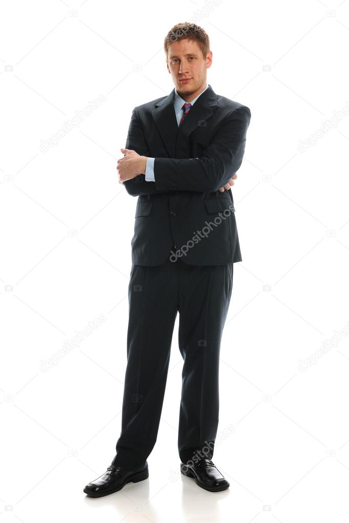 Young Businessman standing with crossed arms isolated on a white background — Stock Photo #14572937