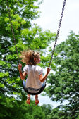 Young Girl on a swing — Stockfoto
