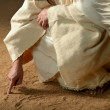 Jesus Writing won the sand — Stock Photo #15002501