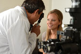 Eye Doctor with female patient — Stock Photo