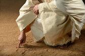 Jezus pisania zdobył piasku — Zdjęcie stockowe