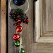 Christmas Ornament hanging from the door — Stock Photo