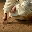 Stockfoto: Jesus Writing on the sand