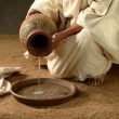 Stock Photo: Jesus pouring water