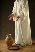 Jesus standing with hands extended — Stock Photo