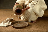 Jesus pouring water — Stock Photo
