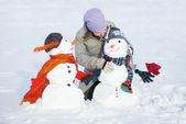 Kardan adam kızla — Stok fotoğraf