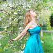 Beautiful blonde girl in spring garden - ストック写真