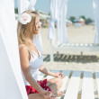 Young woman meditation on the beach — Stock Photo