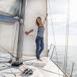 Stock Photo: Womstaying on sailboat