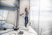 Woman staying on sailboat — Stock Photo