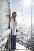 Woman staying on sailboat — Stock Photo