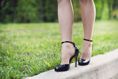 Woman legs and high heels — Stock Photo