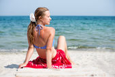 Woman sitting at the beach — Stock Photo