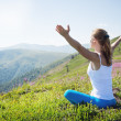 Young woman meditate on the top of mountain — Stock Photo #50968503