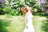 Beautiful bride in spring blossom — Stock Photo