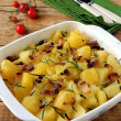 Potatoes baked with rosemary and bacon — Stock Photo