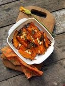 Pumpkin baked with sage and seeds — Stock Photo