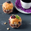 Plum muffins with cup of coffee — Stock Photo