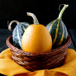 Pumpkin on a wooden table - Stock Photo
