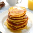 Stack of pancakes with honey — Stock Photo