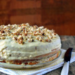 Creamy cake with nuts on top - Stock Photo