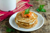 Pancakes with salted salmon — Stockfoto