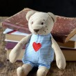Stock Photo: Stack of books and Teddy bear on wooden table