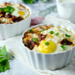 Eggs baked with cheese - Stock Photo
