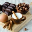 Milk, cinnamon, eggs, chocolate, and  filbert — Stock Photo