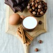Stock Photo: Milk, cinnamon, eggs, chocolate, and filbert
