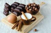Milk, cinnamon, eggs, chocolate, and filbert — Stock Photo