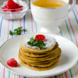 Pancakes with cherry and mint - Stock Photo