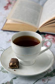 Cup of coffee with book — Stockfoto