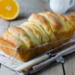 Stock Photo: Brioche with orange glaze