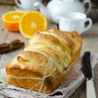 Brioche with orange glaze — Stock Photo