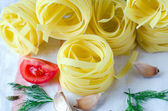 Fettuccine ,tomatoes, spices and herbs — Stock Photo