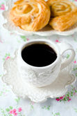 A Cup of coffee and buns . Breakfast — Stock Photo