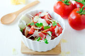 Salad of tomatoes , cheese and watercress — Stock Photo