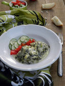 Fish in a sauce of spinach — Stock Photo