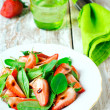 Salad with strawberries and spinach — Stock Photo