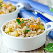 Barley porridge with vegetables - Stock Photo