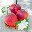 Fresh red apples in a basket — Stock Photo #25080289