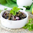 Salad from sea Kale with onion and lemon - Stock Photo