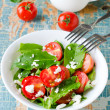 Salad of fresh cherry tomatoes with herbs and cheese — Stock Photo