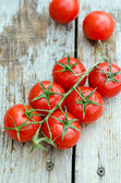 Fresh cherry tomatoes on a wooden table — Stock Photo