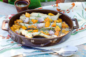 Baked fish with pumpkin — Stock Photo