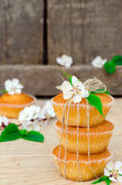 Muffins with filling on the wooden table — Stock Photo